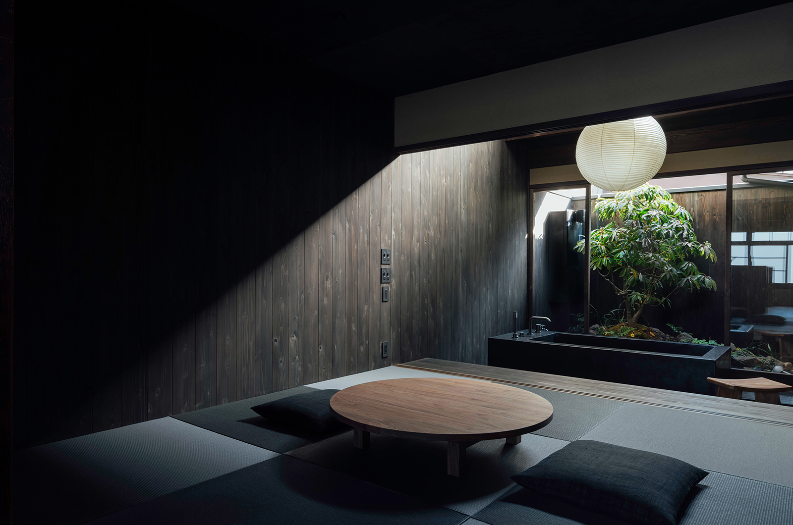 Maana Kamo living area with bathtub and garden